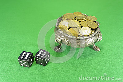 Dice and bowl on three lions feet
