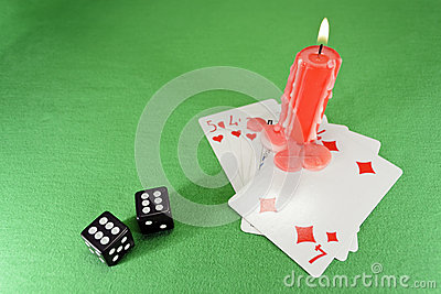 Playing cards, dice and a candle