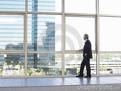 Businessman Looking Out Of Office Window