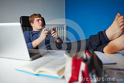 Boy Playing Video Game Instead Of Studying