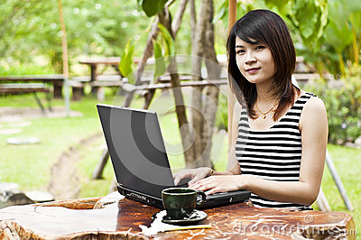 Beautiful Asian woman using computer notebook.