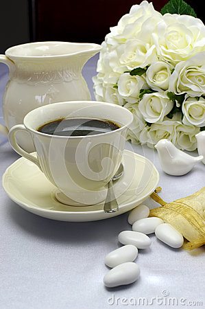 Close up of detail on wedding breakfast dining table setting with fine china coffee cup and milk jug