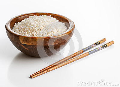 Wooden bowl with rice and chopsticks