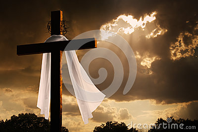 Dramatic Lighting on Christian Easter Cross As Sto