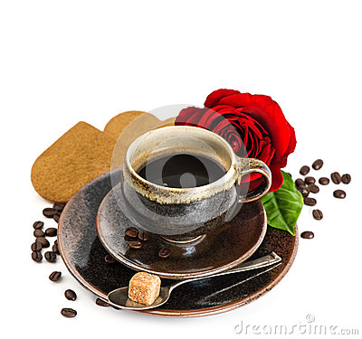 Cup of black coffee and red rose flower and cake on white