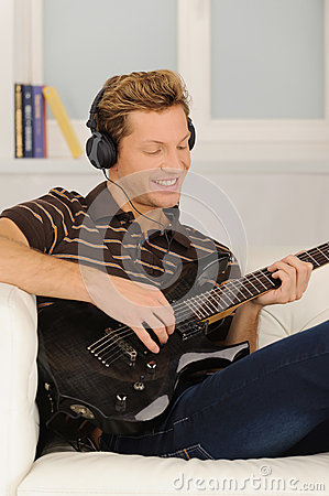 stock image of men playing guitar.