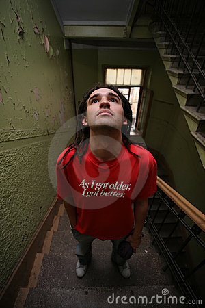Young man standing on stairway