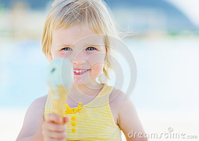 Happy baby showing ice cream