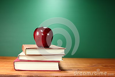 Apple Plus Stack of Books on A Desk for Back to School