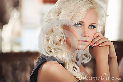 Beautiful woman in cafe restaurant, girl in bar, summer vacation. Pretty blond at breakfast. happy smiling woman