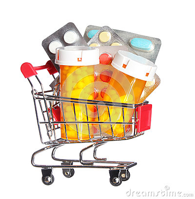 Pill bottle and pills in shopping cart isolated. Concept. Pharmacy