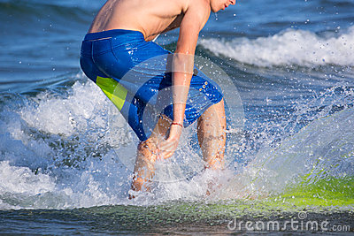 Boy surfer surfing waves on the beach