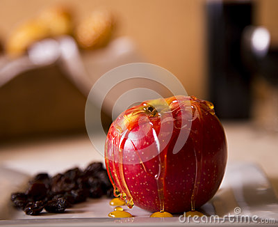 An apple drizzled with honey