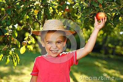Smiling boy with apple