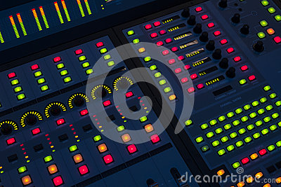 Sound engineer mixing board
