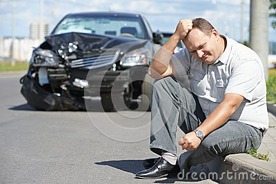 Upset man after car crash