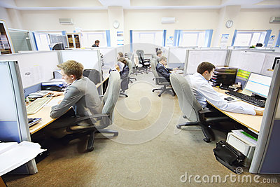 Office workers of company RUSELPROM sit at computers