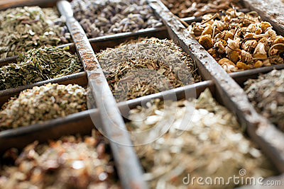 Assorted dried herbs in a printers tray