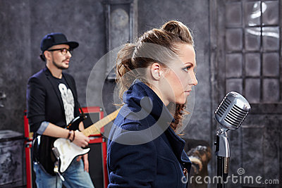 Lead singer stands at microphone