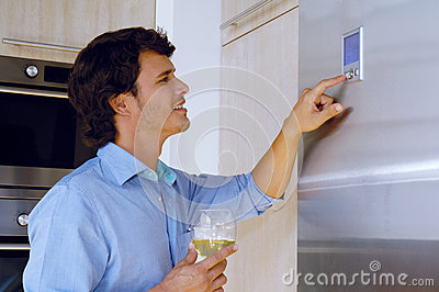 Man looking on refrigerator