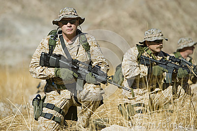 Soldier With Rifle While Team Patrolling During War