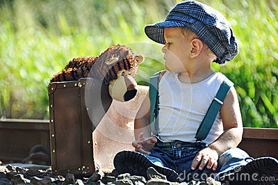 Little infant boy sharing secrets with best friend
