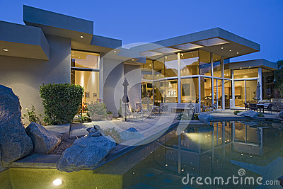House With Pool In Backyard At Dusk