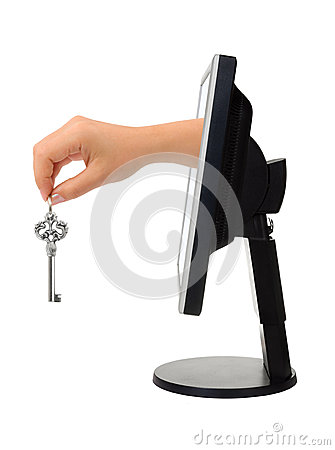Computer screen and hand with key