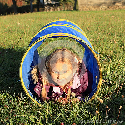 Girl in blue kids tunnel