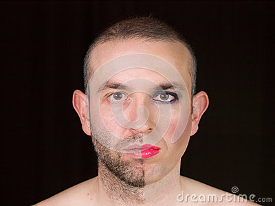 Portrait of a man with half face makeup as a woman