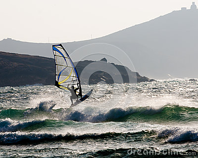 Wind surfer jumping a wave