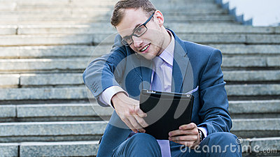 Young happy smiling business man working with tablet, horizontal portrait.