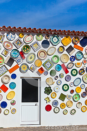 Traditional portuguese pottery plates on a wall in Algarve