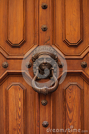 Old doorhandle in the form of a woman's face