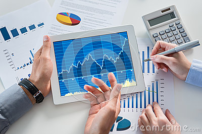 Businesspeople Analyzing Graph With Digital Tablet