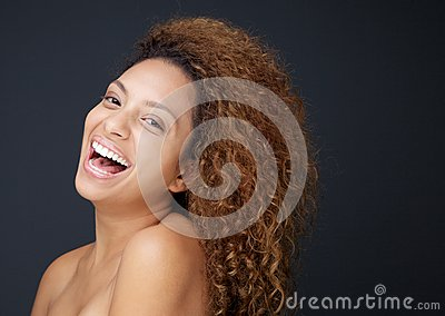 Beautiful young woman with naked shoulders laughing