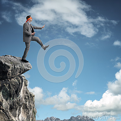 Stepping off a cliff ledge