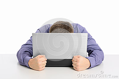 Man frustrated with his laptop computer