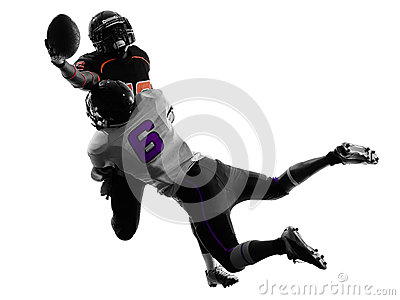 Two american football players tackle silhouette