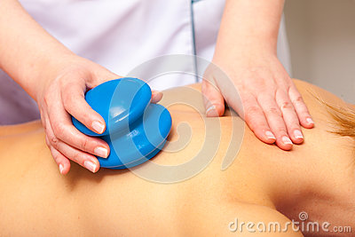 Spa salon. Woman relaxing having cupping-glass massage. Bodycare.