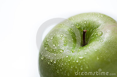 Drops on a green apple