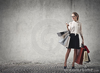 Woman shopping checking her phone