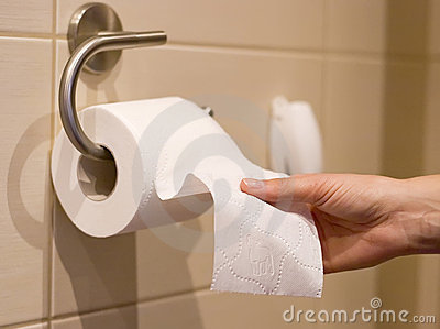 Hand reaches for toilet paper