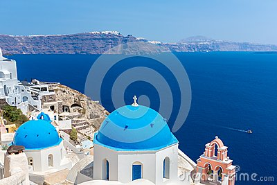 The most famous church on Santorini Island, Crete, Greece. Bell tower and cupolas of classical orthodox Greek church