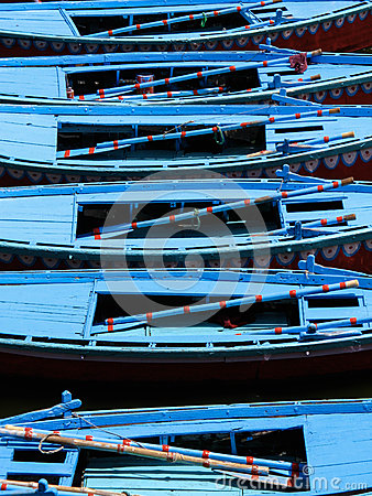 Row Boats Floating on the Ganges River in Varanasi, India