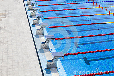 the row of starting blocks of a swimming pool
