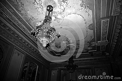 Room chandelier hanging in a dark grungy room mozeypictures Gallery