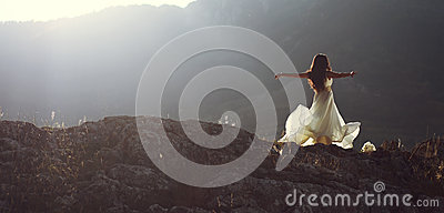 Beautiful woman spinning with arms open