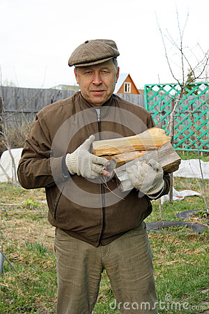 Country man with firewood