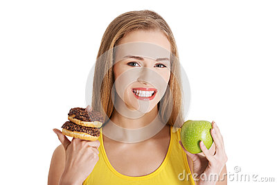 Beautiful caucasian casual woman with doughnuts and apple.